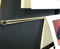 Good display idea: string a rubber band between two screws or nails, and drape your stuff/cards over it.