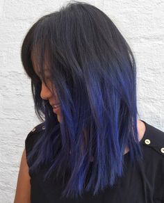 medium layered black hair with blue highlights