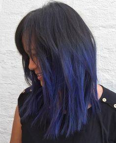 medium layered black hair with blue highlights