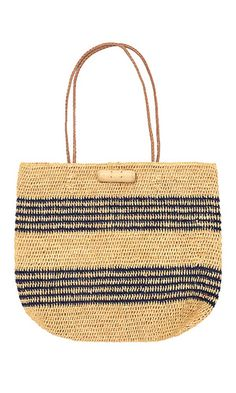 Crafted in Madagascar by local artisans, this roomy, nautical striped tote has a relaxed, beachy look.