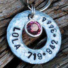 Hurley needs one!  We will have to figure out if her bday is Jan or Feb!    Pet ID Dog Tag Hand Stamped  Lola by caninecloset on Etsy, $10.00