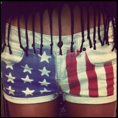 DIY American flag shorts! Place star stickers on one side and painters tape on the other. Then use Tulip fabric spray paint in sapphire and scarlet. Let it dry then peel off painters tape and sticker! Ps- make sure to put a piece of cardboard in shorts so the dye doesnt bleed through.