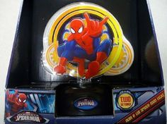 "Spiderman Neon & LED Light by Marvel. $29.95. Includes: Light Base, Illustrated Acrylic Inserts, Neon Tube. Powered by AC/DC Adapter (Included). Lamp is 12"" Tall and Base measures 6.5"" in diameter. Ultimate Spiderman Neon and Led Light. Product Description Does you little one love Spiderman? If so then this Spiderman Neon & LED lamp would be perfect for their room! Featuring the words Spiderman on the base and Spiderman lighting up in his classic pose. This lamp stands 14"" ..."