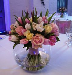 Spring vase centrepiece of tulips and roses in ivory, pale cream and pale pinks, taken at recent wedding at Clandon Park, Surrey where we are recommended florists. For more wedding inspiration from Clandon please visit http://www.thefineflowerscompany.co.uk/clandon_house_david_austin.html