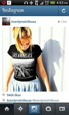 LA shirt and denim skirt