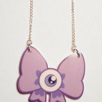 Complete your creepy-cute look with this eyeball-bow necklace!    From Catscratch on storenvy.com    100% waterproof acrylic charm (2inch)