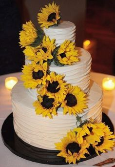 Sunflower Wedding | Sunflower wedding cake | Wedding stuff @Jane Daly Taylor I love the way the icing is but with less flowers!