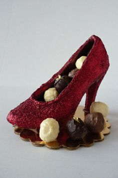 milk chocolate ruby slipper with truffles....I know someone that this would be perfect for. :-)