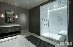 Luxury-Bathroom-Design-Equipped-Glass-Shower-Room-With-Black-Sofa-Benches-Beside-White-Bathtub-And-Cool-Vanity-Mix-Black-Frame-Mirror-And-Stunning-Two-Wall-Lamps-on-Neutral-Interior-Design – Primadr Glass Bathroom, Glass Shower Doors, Bathroom Interior, Shower Bathroom, Bath Tub, Bathroom Trends, Bathroom Ideas, 1950s Bathroom, Glass Doors