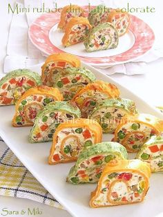 Appetizer - cream cheese, feta, sour cream, chopped peppers and olives, dill thyme, gelatin.  Recipe for naturally colored tortillas (pancakes) from Romania