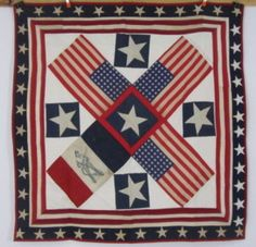 An unusual rare quilt to find with 48 star flags and a fireman flag.     It measures 50 x 51 inches. Has moth nibble holes in places and age spotting.  A rough making with machine sewn edges. Machine tacked together.