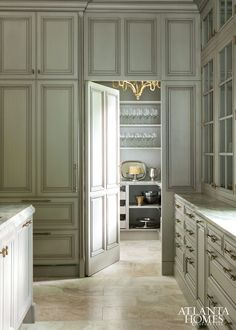Secret door to the best butler pantry ever. Design by Design Galleria Kitchen and Bath Studio | Photographed by Erica George Dines | Atlanta Homes & Lifestyles |