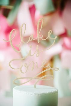 cool cake topper idea - like to see this with other works for a wedding