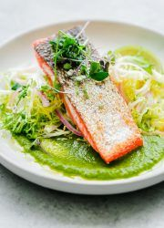 Seared Sockeye Salmon with Green Adobo Sauce and Frisée Salad. This elegant main course recipe can be prepared in less than 45 minutes!