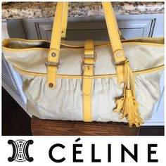 Celine Canvas Oversized bag Oversized Celine canvas bag with leather trim. Excellent condition! The leather trims are so vibrantly bright yellow with gold hardware through out which each and every hardware has either the logo or Celine prints on! This is a bag any Celine girl would wants to travel on; you can throw in your magazines, iPad, books and or laptop! This bag is so roomy and in the same time you can also use this bag as your everyday shoulder hobo bag by clipping in the middle…