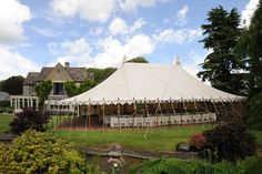 One of our Traditional Canvas Pole Tent with open sides.