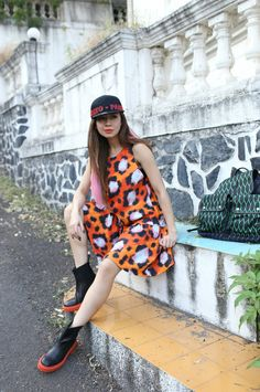 Kenzo x H&M is a collaboration that speaks to the world. #Fashion #Colors #AnimalPrint #Orange #SnapBack