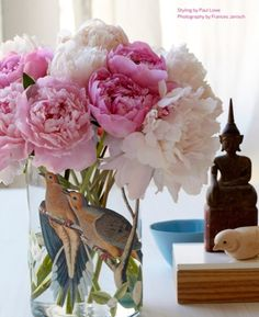 One of my favorite flowers! Love the vase, too.