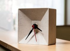 This Instructable will show you how to cast a fiber-reinforced concrete clock in a melamine box, using a foam knockout to recess the clock hands and mechanism. ...