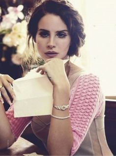 Lana Del Ray. I like her individuality. She has a unique voice and she takes a beautiful picture.