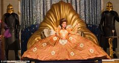 Memorable: Roberts takes a set on a golden shell-like throne in another huge gown