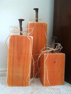 2 x 4 wood pumpkins with railroad spike stems