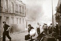 Civilians carry belongings out of burning houses (Minsk July 1944) http://wrhstol.com/1Msp099