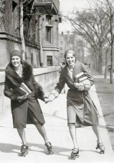 Two women students roller-skating on midway sidewalk :: University of Chicago campus, ca. 1940