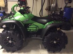 2014 Honda Rincon - I love my new machine and here is a few things that I have added , Camaro green dip, 14 in rims with 30 inch gorilla silverback tires, snorkel kit with 2 inch lift, Big gun exhaust and I'm not done. I will be adding winch and sounds.