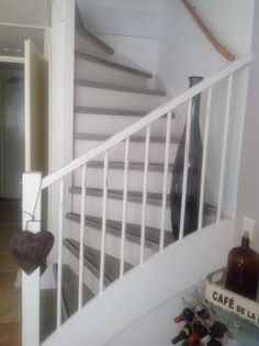 A bit of a shabby chic look to the railings to compliment the wooden staircase