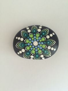 A personal favorite from my Etsy shop https://www.etsy.com/listing/452555316/mandala-stone-hand-painted-rock-dot