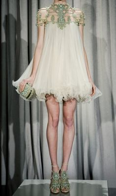 Marchesa. OMG I love this! I so want the top for my wedding dress, soooo pretty :)