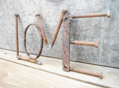 Hey, I found this really awesome Etsy listing at https://www.etsy.com/listing/189603093/metal-love-sign-metal-word-artrusty Welding Crafts, Welding Art, Welding Projects, Welding Ideas, Outdoor Metal Wall Art, Metal Yard Art, Scrap Metal Art, Metal Tree Wall Art, Metal Projects