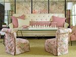In this feminine space, from the Southern Accents showhouse at Reynolds Plantation in Greensboro, Georgia, the sitting room's pink palette i...