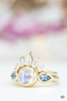 Here's a rose cut in action! I love the look of this cut on this moonstone. In fact, I'm not sure we've ever made a ring with a rose cut moonstone before, and it's always fun to find a new combination! The color play here is wonderful -- with the blue-ish hue of the adularescent moonstone reflected in the aqua side stones, and the bright sparkle of the sunburst arrangement from the matching band. A gorgeous look that started from this customer's sketched ideas! 😍 Classic Engagement Rings, Moonstone Ring, Her Style, Ring Designs, Hue, Stones, Sparkle, Action, Stud Earrings