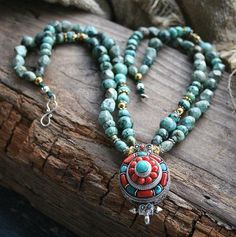 Beautiful necklace made from African Turquoise gemstones and decorated with a Ghau (Gau) box pendant - Made by look4treasures