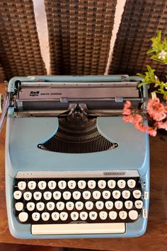 You can borrow my typewriter (looks just like this - vintage 1960s corona) for your guestbook if you like that idea.