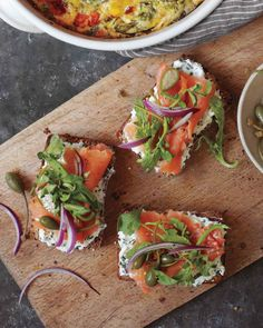 Seeded-Bread Tartines with Herbed Goat Cheese and Smoked Salmon,  This open-faced sandwiches make a lovely addition to brunch gatherings.