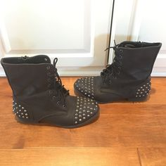 SPIKED COMBAT BOOTS FOREVER 21 SPIKED COMBAT BOOTS. BLACK 'PLEATHER' MATERIAL WITH SILVER SPIKES. WORN ONE TIME, IN GREAT CONDITION. ZIPPER ON INNER SIDE. SIZE 8. Forever 21 Shoes Combat & Moto Boots