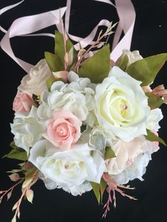 Beautiful soft pink and white real touch roses come together with some hydrangea to create a very romantic bouquet sure to compliment any wedding gown. And of course a little bit of bling in each flower to make it shine  All bouquets can be reproduced in the size and colour of your choice. Feel free to mix and match ideas to make your bouquet more individual. Corsage, MOB and Lapel pins are also available to match your colours. Contact leeann@bejewelledbridal.com.au for more information.
