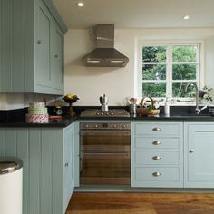 Like the blue cabinets with hardwood floors