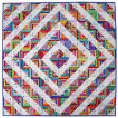Barn Raised Log Cabin Quilt - @Rita - Red Pepper Quilts has mesmerized readers with a unique twist on a traditional barn raised quilt pattern. Use small log cabin quilt blocks in your favorite colors to create a kaleidoscope effect.