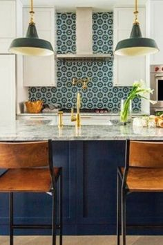 I love the navy island and the white upper cabinets. I also like an area of accent tile in the kitchen.