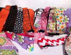 Designer fabrics put to fun use!  Prices range from $8-$14. (Find me on Facebook at Ahuva Penina Designs).