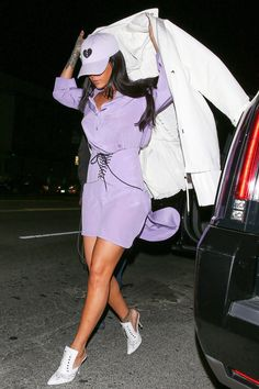 Rihanna sports a lavender corset over a boyish Chanel shirtdress.