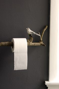 Toilet paper hanger from a stick. I especially like the bird.