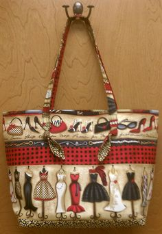 Jelly Roll bag pattern inspired this bag. I just love the border fabric idea.
