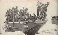 United States Marine Corps reinforcements at Guadalcanal debark from an LCP(L). Though the surf is light and there is no enemy fire apparent, these men are still presented with some balancing challenges and a tall leap from the bow.