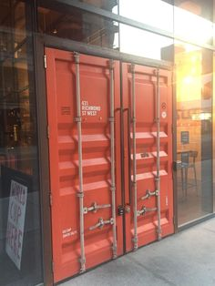 container doors used as front doors on this bar. Industrial Office Design, Industrial House, Industrial Interiors, Container Home Designs, Container Buildings, Shipping Container Homes, Shop Front Design, Door Design, Home Interior Design