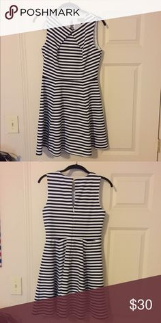 The Limited Navy and White Stripped Dress Navy and white stripped dress with a gold button with an anchor on the back. Worn 2-3 times. In great condition. The Limited Dresses Mini